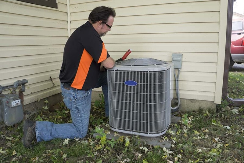 man performing an ac tune-up
