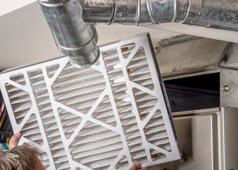 Changing the filter in the furnace of a Marmora, NJ home