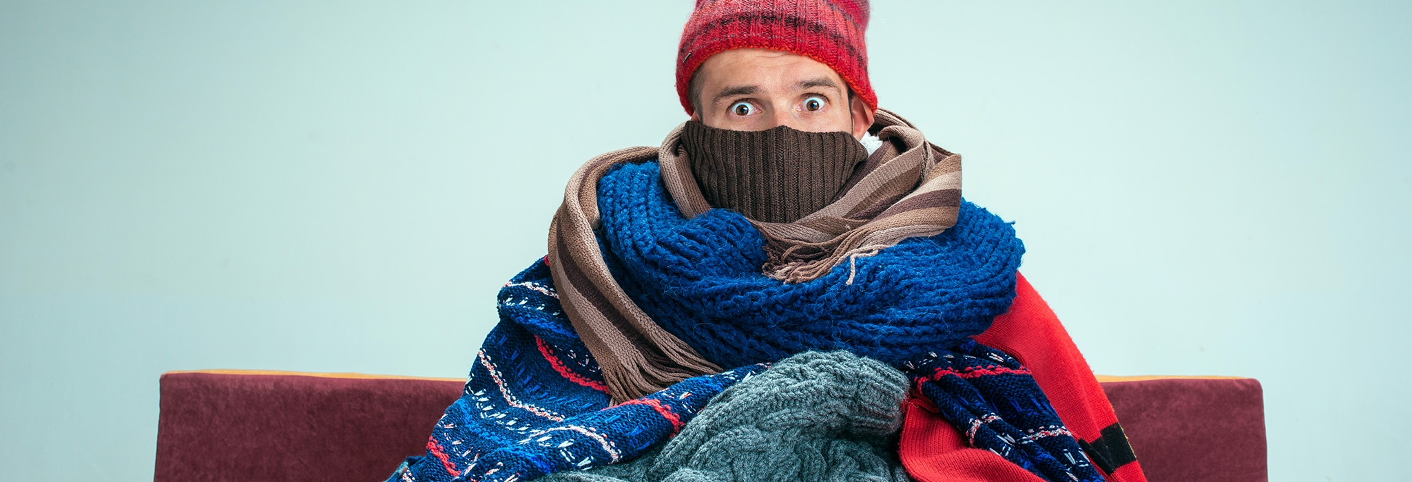 Person bundled up in warm clothing.